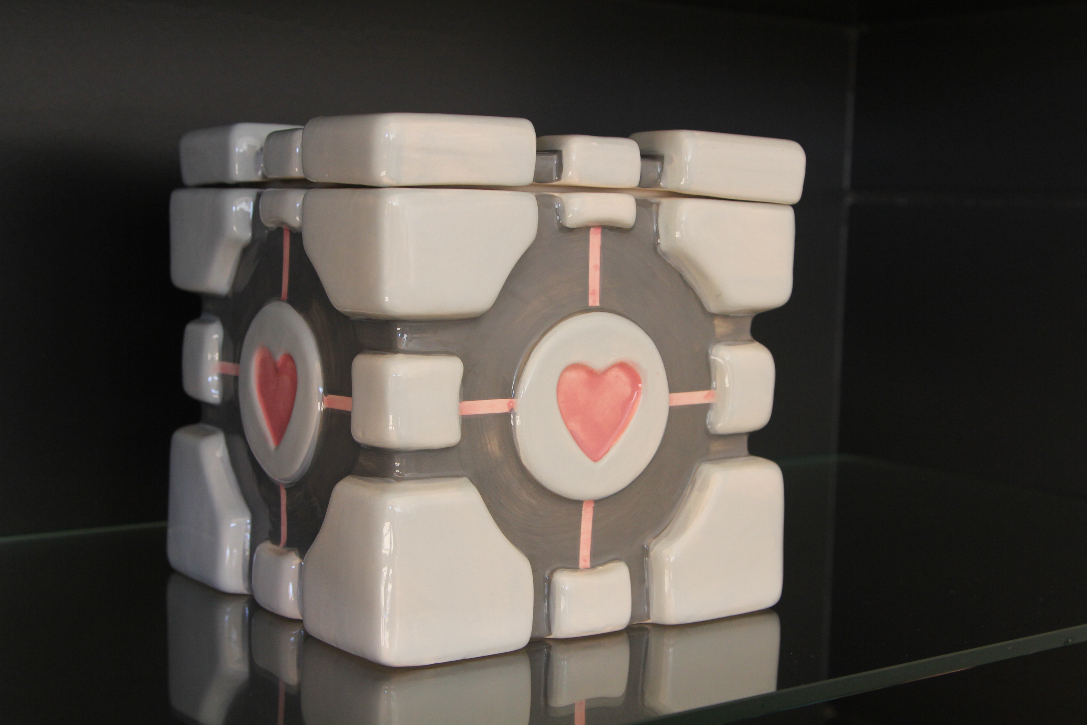 """Your Aperture Science Weighted Companion Cube will never threaten to stab you, and in fact cannot speak. If your Weighted Companion Cube does speak, please disregard its advice"". - GLaDOS, Portal."